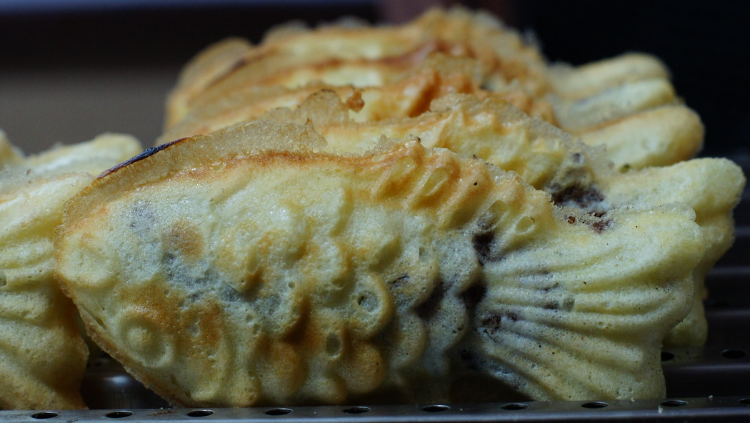 Today's daily travel photo is of Bungeoppang (붕어빵): Korean snack or dessert that is shaped like a fish and filled with sweet red bean paste.