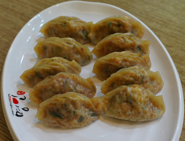 Korean dumplings known as Kimchi Mandu (김치만두) are a popular Korean side menu or snack.  They can be steamed, fried or boiled.