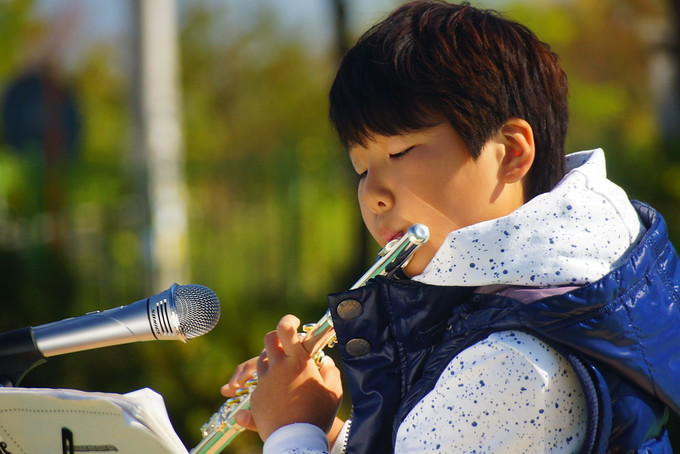 Korean student playing music