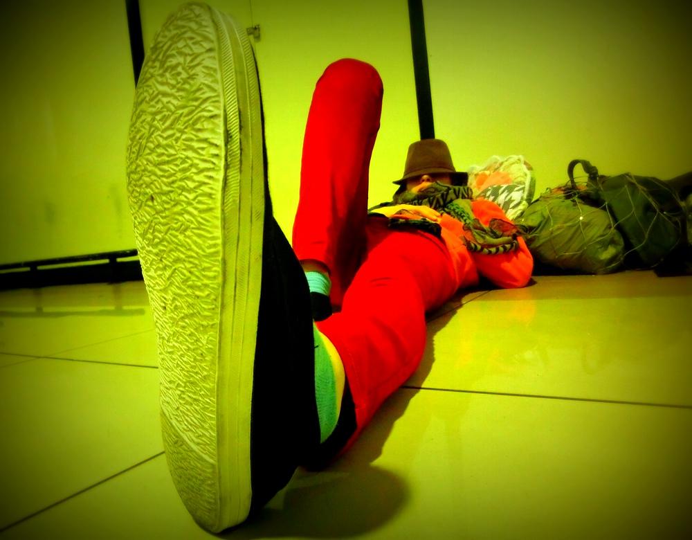 Audrey sleeping on the floor at Kuala Lumpur International Airport LCCT