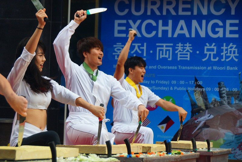 This is a travel image of Nanta Korean performers where knives are being wielded in this non-verbal comedy that delighted a large crowd in Seoul's Myeongdong.