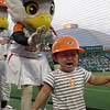 "This Korean boy is scared by the baseball Mascot during a Hanhwa Eagles game in Daejeon, South Korea.  Travel photo from my Korean baseball gallery. <a href=""http://nomadicsamuel.com"">http://nomadicsamuel.com</a>"