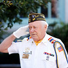 Pittsfield VFW Post 448 Commander Arnie Perras salutes for the pledge of allegiance during a small ceremony outside of City Hall in Pittsfield to commemorate those who fought and died in the Korean War on Saturday, July 31, 2021.
