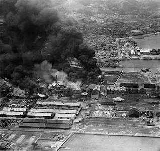 Carrier planes strike Wonsan refinery, July 1950.