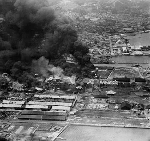 Carrier planes strike Wonsan refinery, July 1950.
