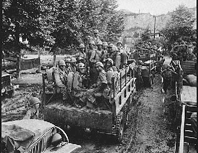Men of the 24th Infantry Regiment move up to the firing line in Korea.