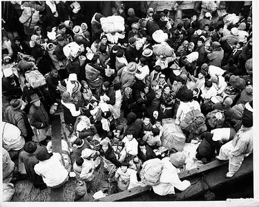 14,000 Korean evacuees from Hungnam, Korea aboard the SS Meredith Victory.