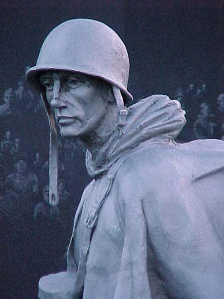 "Nearly 2,500 American troops' faces are etched into the black granite of the Korean War Veterans Memorial in Washington.  The Memorial also features 19 soldiers who represent the American Navy, Air Force, Army, and Marines and a South Korean soldier who fought with them.  Dedicated in 1995, a plaque at the Korean Memorial honors the 1.5 million Americans who defended ""a country they never knew and a people they never met."""