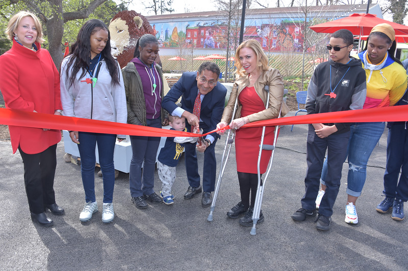 Amy Shearer, Chief Marketing Officer at The Philadelphia Zoo, Vikram H. Dewan, president and CEO of the Philadelphia Zoo and Sheila Hess, City Representative cut the ribbon to Urban Green with the help of local school kids