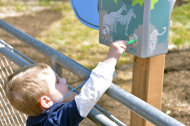 A boy trying out his Zoo Key to unlock insider secrets and stories about the magnificent creatures living at Philadelphia Zoo, told by animal keepers who care for them.