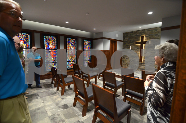 -Messenger photo by Jesse Major<br /> Visitors look at the new non-denominational chapel at Kussuth Regional Health Center during its dedication Sunday.