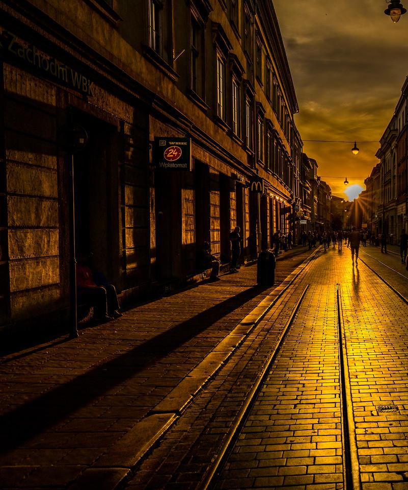 Krakow square side street at sunset