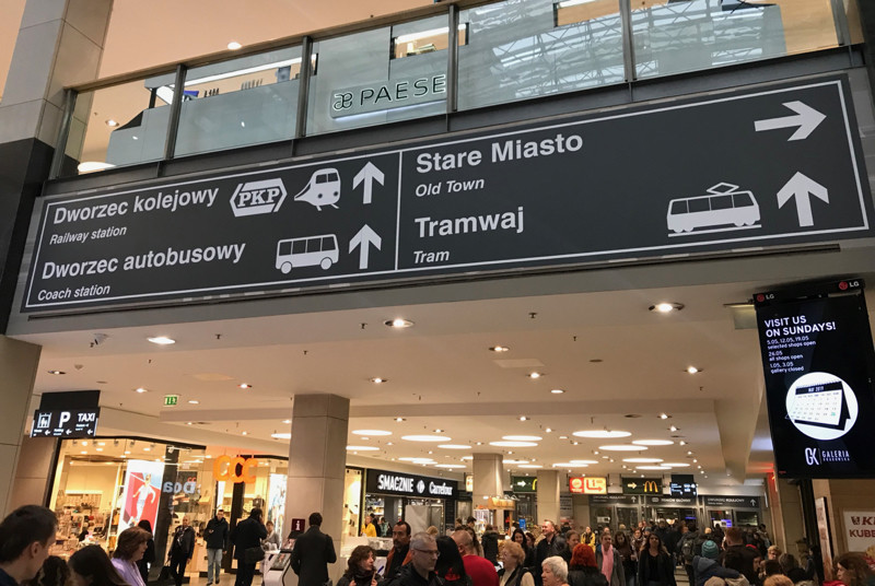 Signs for train and bus stations in Galeria Krakowska