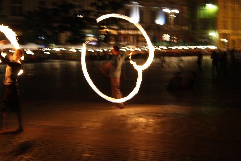 Some people dancing with fire in the market square in Krakow, copyright Lars K Jensen