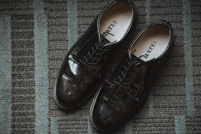 Patent leather shoes.
