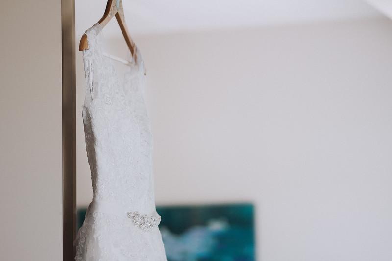 Wedding dress hanging in a doorway.