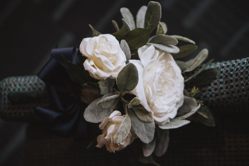 Bouquet of flowers wrapped in thick ribbon.