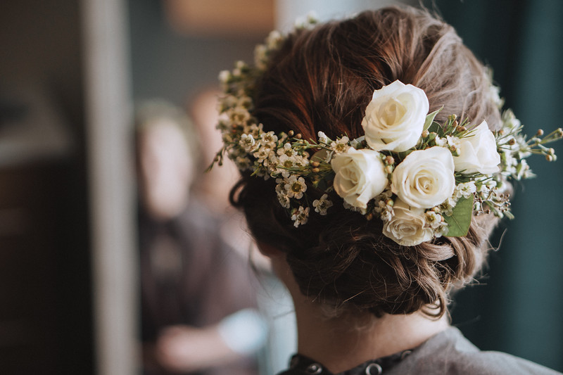 Bride's hair wrapped in a flower crown.