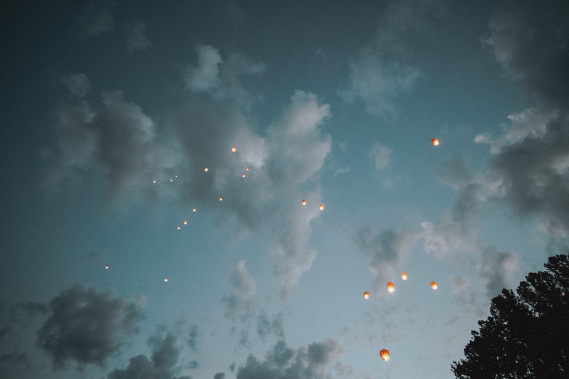 Chinese lanterns dot the cool summer evening sky.