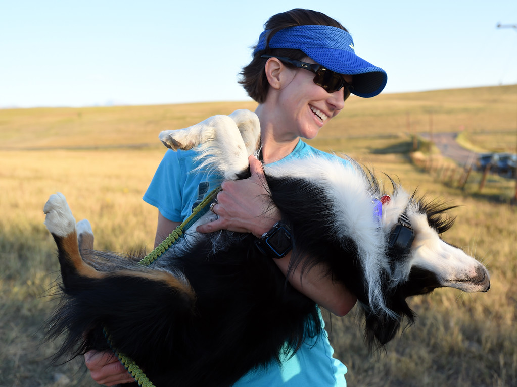 . Kristin Gablehouse hugs her dog, Kili, after finishing  a training run south of Boulder on Tuesday.  Kristin Gablehouse, of Lafayette, suffered a brain injury after a cycling accident in 2015. She\'s been on the road to recovery and returning to running ultramarathons.  Cliff Grassmick  Staff Photographer September 12, 2017