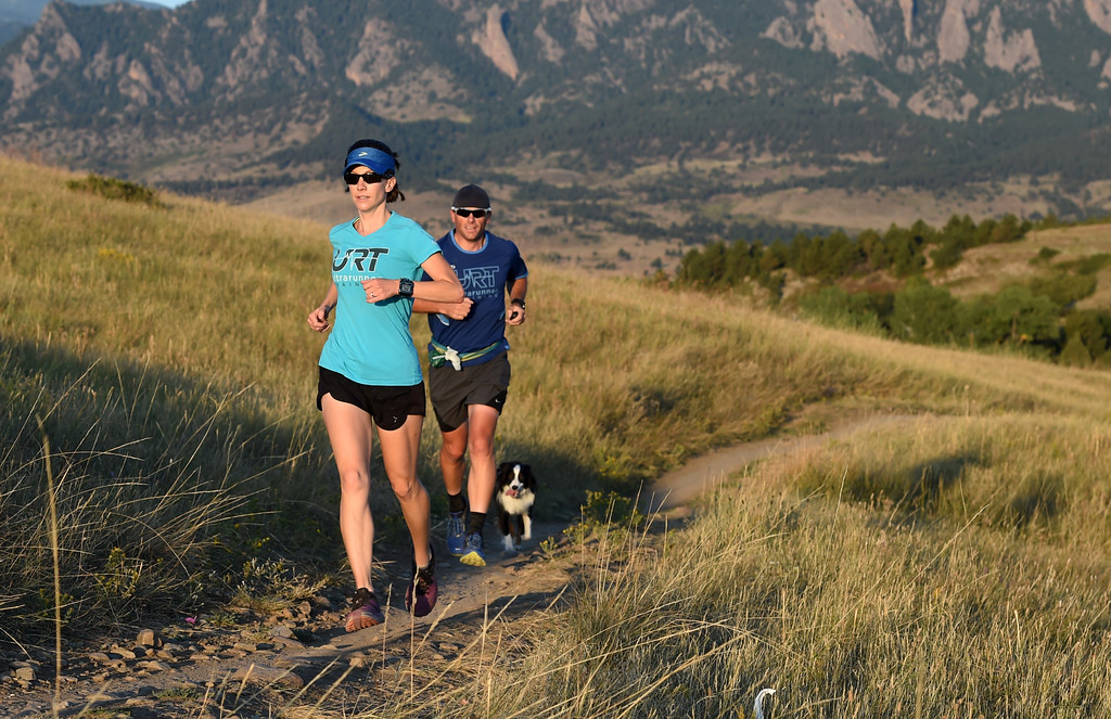 . Kristin Gablehouse, left, her husband, Josh Lawton, and dog, Kili, go on a training run south of Boulder on Tuesday. Kristin Gablehouse, of Lafayette, suffered a brain injury after a cycling accident in 2015. She\'s been on the road to recovery and returning to running ultramarathons.  Cliff Grassmick  Staff Photographer September 12, 2017