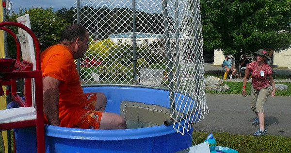 This photo was taken by Claye Curtis. Charles Barnard, BMWMOGA president, is in the dunking booth, and I'm trying to dunk him.