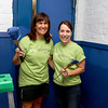 Employee's from Kronos were volunteering painting, landscaping and cleaning up the Cardinal O'Connell School, off Gorham Street on Wednesday. Employees Donna Crowley and Mary Palermo were all smiles as they helped fix up the school. SUN/JOHN LOVE