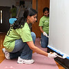 Employee's from Kronos were volunteering painting, landscaping and cleaning up the Cardinal O'Connell School, off Gorham Street on Wednesday. Employee's Vijaya Mula and Latha Sadineni paint one of the walls in the school. SUN/JOHN LOVE