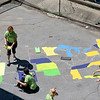 Employee's from Kronos were volunteering painting, landscaping and cleaning up the Cardinal O'Connell School, off Gorham Street on Wednesday. On the hot top in the back of the school some of them painted the United States with all fifty states. SUN/JOHN LOVE