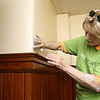 Employee's from Kronos were volunteering painting, landscaping and cleaning up the Cardinal O'Connell School, off Gorham Street on Wednesday. Employee Maureen Chmielecki fixes the cracks in one of the walls in the school. SUN/JOHN LOVE