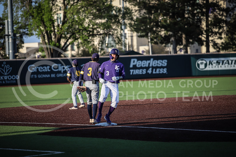 Senior Cameron Thompson getting to third base safe on Wednesday's game (April 14, 2020) against the University of Northern Colorado at Tointon Baseball Stadium. <br /> Elizabeth Proctor Collegian Media Group