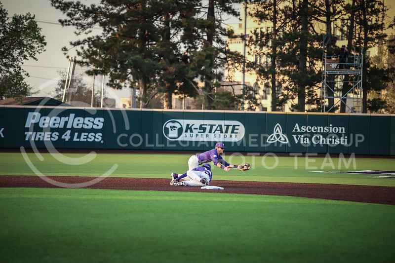 ...... catching the ball at second base on Wednesday's game (April 14, 2020) against the University of Northern Colorado at Tointon Baseball Stadium. <br /> Elizabeth Proctor Collegian Media Group