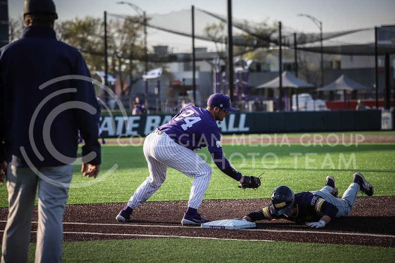 Sophomore Dylan Phillips trying to secure an out at first base on Wednesday's game (April 14, 2020) against the University of Northern Colorado at Tointon Baseball Stadium. <br /> Elizabeth Proctor Collegian Media Group