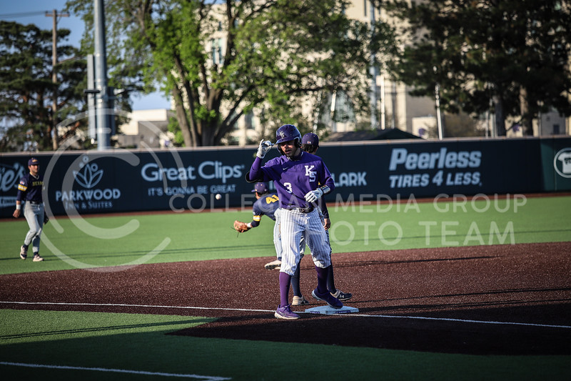 Senior Cameron Thompson getting to third base safe and showing off on Wednesday's game (April 14, 2020) against the University of Northern Colorado at Tointon Baseball Stadium. <br /> Elizabeth Proctor Collegian Media Group