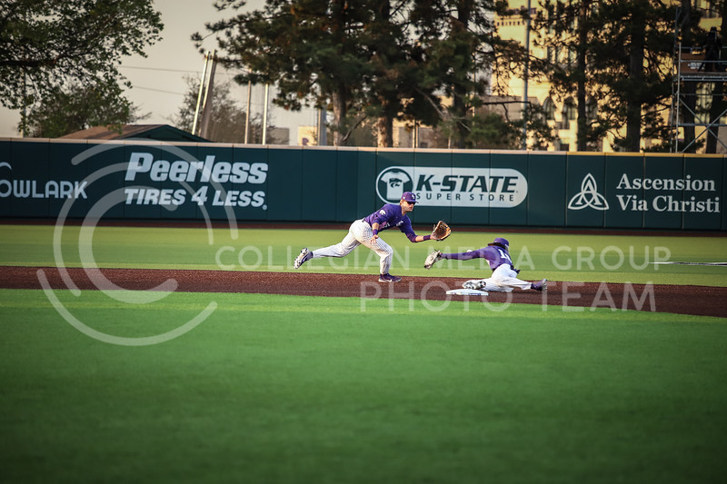 ..... and Junior Kamron Williams reaching for the ball on Wednesday's game (April 14, 2020) against the University of Northern Colorado at Tointon Baseball Stadium. <br /> Elizabeth Proctor Collegian Media Group