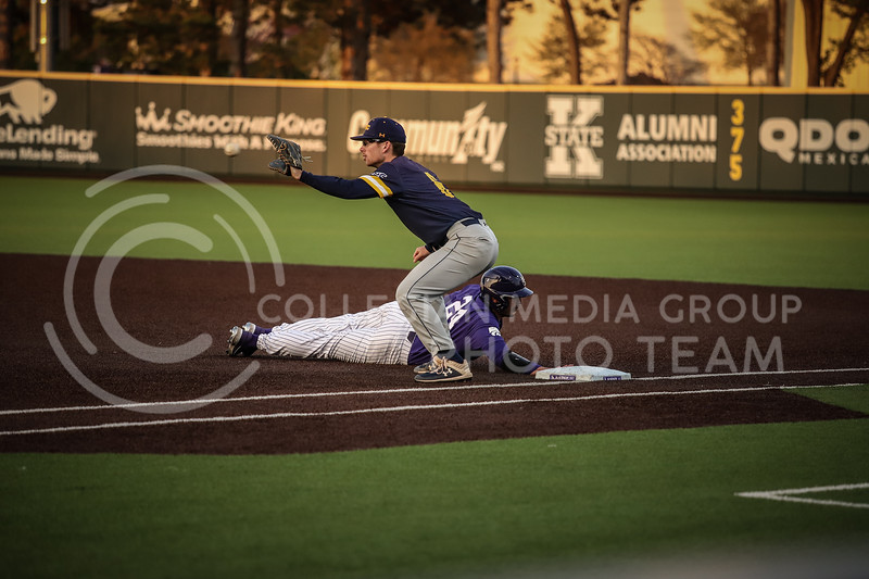 Sophomore Dylan Phillips diving back for first base on Wednesday's game (April 14, 2020) against the University of Northern Colorado at Tointon Baseball Stadium. <br /> Elizabeth Proctor Collegian Media Group