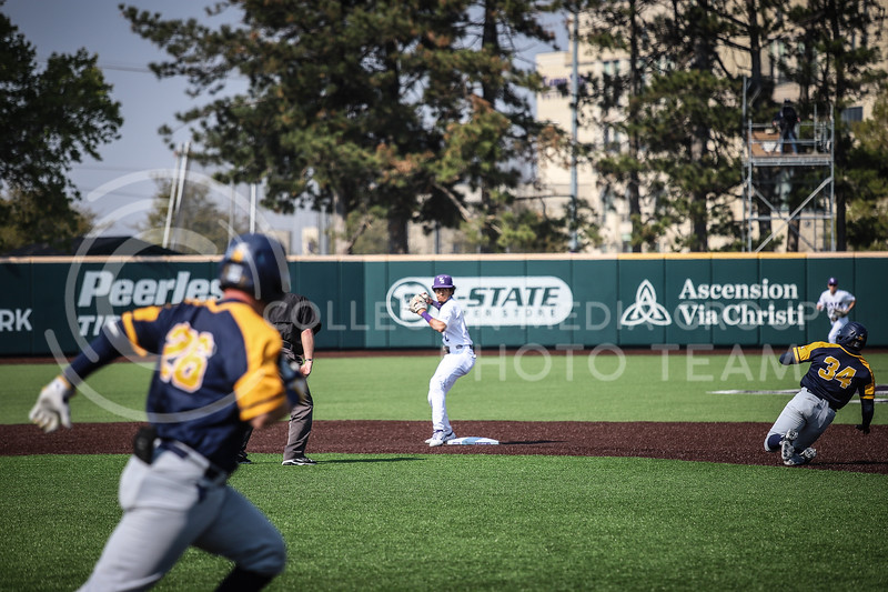 Redshirt Junior Kamron Willman assisting in a double play throwing to first base on Saturday (April 24, 2021) game against Western Virginia at Toniton Stadium. <br /> Elizabeth Proctor Collegian Media Group