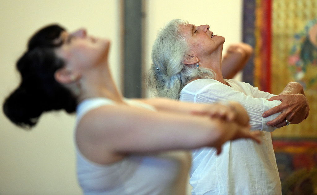 . Shelley Zacks participates in a Kundalini yoga class on Monday at Raj Yoga and Meditation in Boulder. For more photos of the class go to dailycamera.com Jeremy Papasso/ Staff Photographer 07/02/2018
