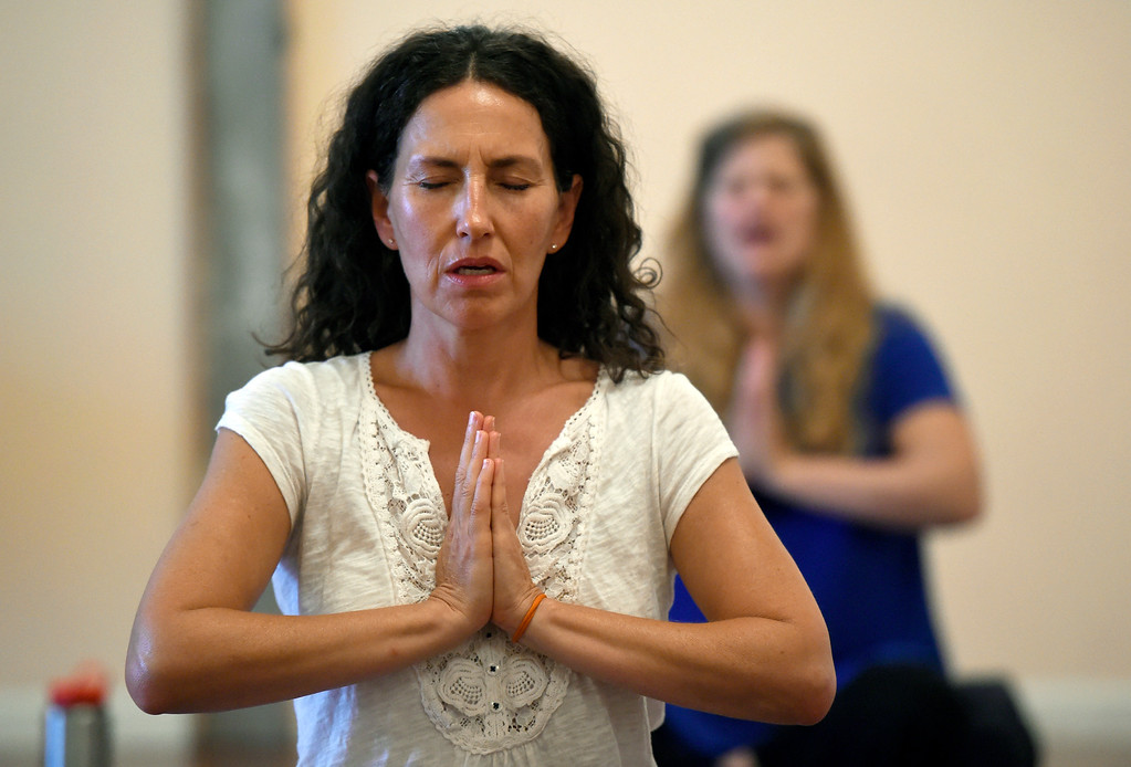 . Eva Avjean participates in a Kundalini yoga class on Monday at Raj Yoga and meditation in Boulder. For more photos of the class go to dailycamera.com Jeremy Papasso/ Staff Photographer 07/02/2018