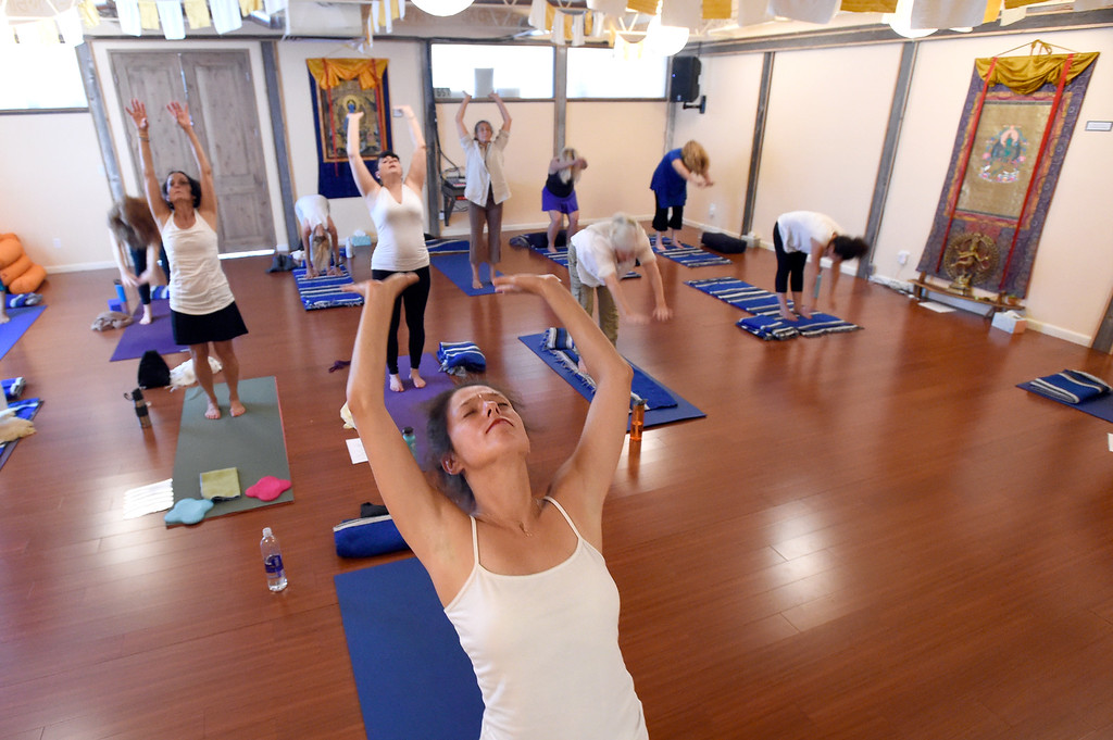 . Crystal Seren, front,  participates in a Kundalini yoga and meditation class on Monday at Raj Yoga and Meditation in Boulder. For more photos of the class go to dailycamera.com Jeremy Papasso/ Staff Photographer 07/02/2018