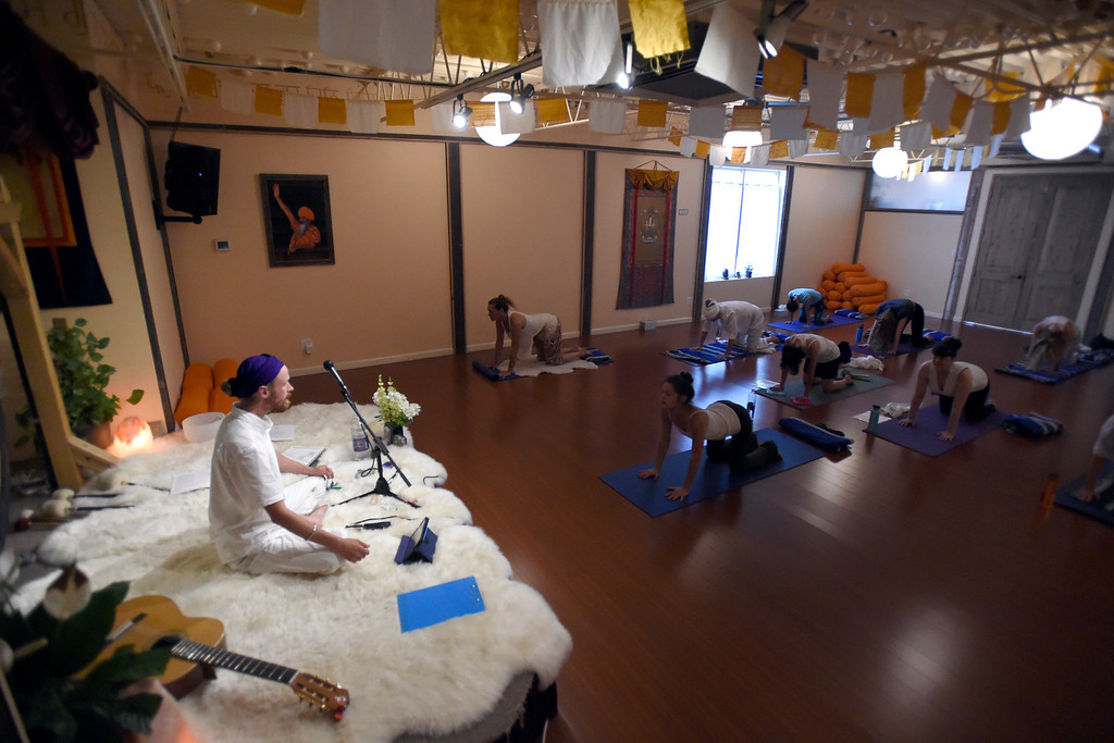 . Instructor Eric Gurmukh Klema, left, leads his class in a Kundalini yoga and meditation class on Monday at Raj Yoga and Meditation in Boulder. For more photos of the class go to dailycamera.com Jeremy Papasso/ Staff Photographer 07/02/2018