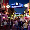 Busy streets with colourful lighting and lots of people very busy, near Beatlesplatz, Reeperbahn and St Pauli, Hamburg, Germany. (Photo by In Pictures Ltd./Corbis via Getty Images)
