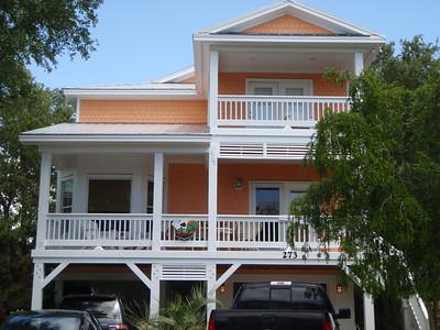 Sample orange house paint color - Seawatch development