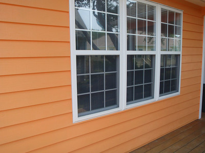 Siding boards were replaced under the Den windows then painted