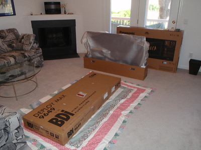 "The living room was used for assembling the TV stand and 55"" TV"