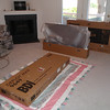 """The living room was used for assembling the TV stand and 55"""" TV"""