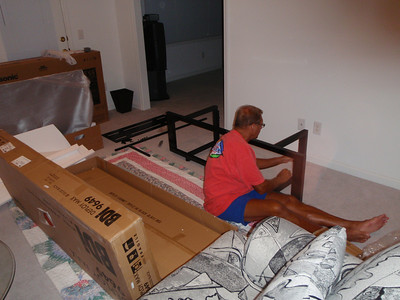 Putting together the TV stand in the living room