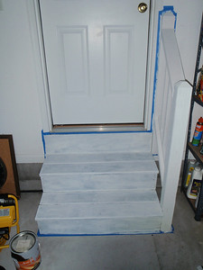 Garage steps and new handrailing are primed.