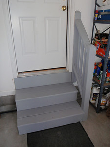 Dennis painted the garage steps and railing in gray to match the front porch steps and the back deck.