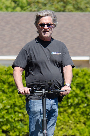 Kurt Russell cruises with his Green Scooter